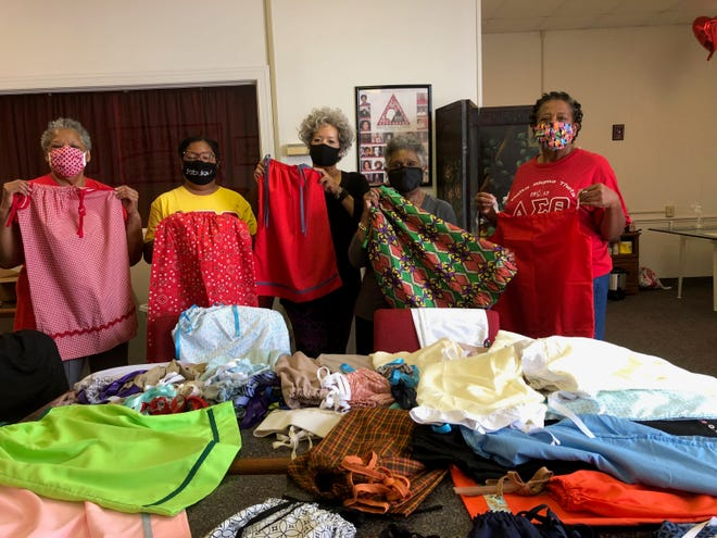 The Little Dresses for Africa is a project the New Bern Alumnae Chapter Delta Sigma Theta Sorority conducted as part of its Five-Point Programmatic Thrust, one of which is International Awareness and Involvement.  Chapter members donated pillowcases and used their sewing skills to make dresses for girls in Africa. Over one hundred dresses were donated to the African Methodist Episcopal Zion (AMEZ) Church Global Missions for a church school in Zimbabwe.  Pictured are Fern Cotton, Natalie Standifer, president, Zeda Trice, Ann Herndon and Teresa Parker. [CONTRIBUTED PHOTO]