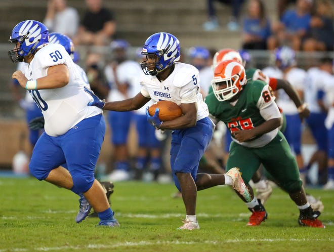 St. Augustine Menendez running back Tabias Brown looks for a hole in the Eastside defense Thursday at Citizens Field. The Rams lost to the visiting Falcons 28-3. [Brad McClenny/Staff photographer]
