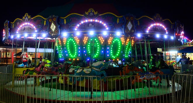 Attendees enjoy the Merry-Go-Round during the 2019 Etowah County Fair in Attalla. This year's event starts Tuesday and runs through Saturday.