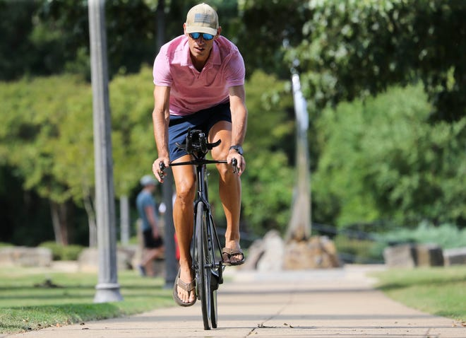 Blake Gill is doing a triathlon this weekend to raise money to support medical professionals in the DCH Health System.  Gill is photographed Friday, Sept. 18, 2020, on the Tuscaloosa Riverwalk. [Staff Photo/Gary Cosby Jr.]