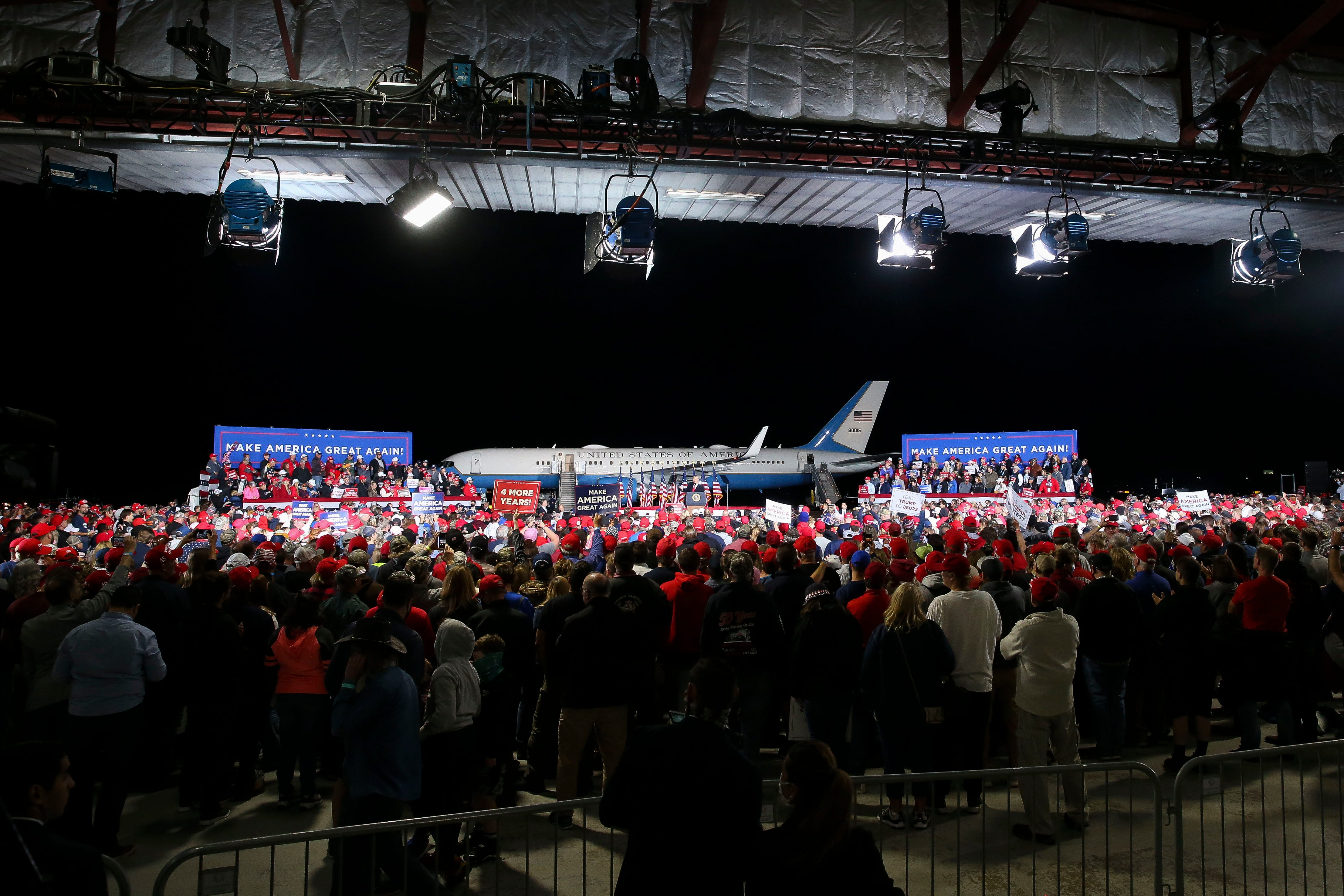 Supporters listen to President Donald Trump's remarks during his campaign rally on Thursday, Sept. 17, 2020, at the Central Wisconsin Airport in Mosinee.