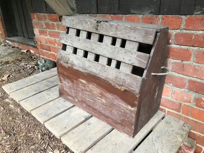 A reader said he found this bin at a house in Asheville dating to 1907, but he doesn't know what it was made for. Other readers weighed in on what its purpose was, including giant shoe shine kit, a portable pigeon roost and a World War II era mail collection bin.