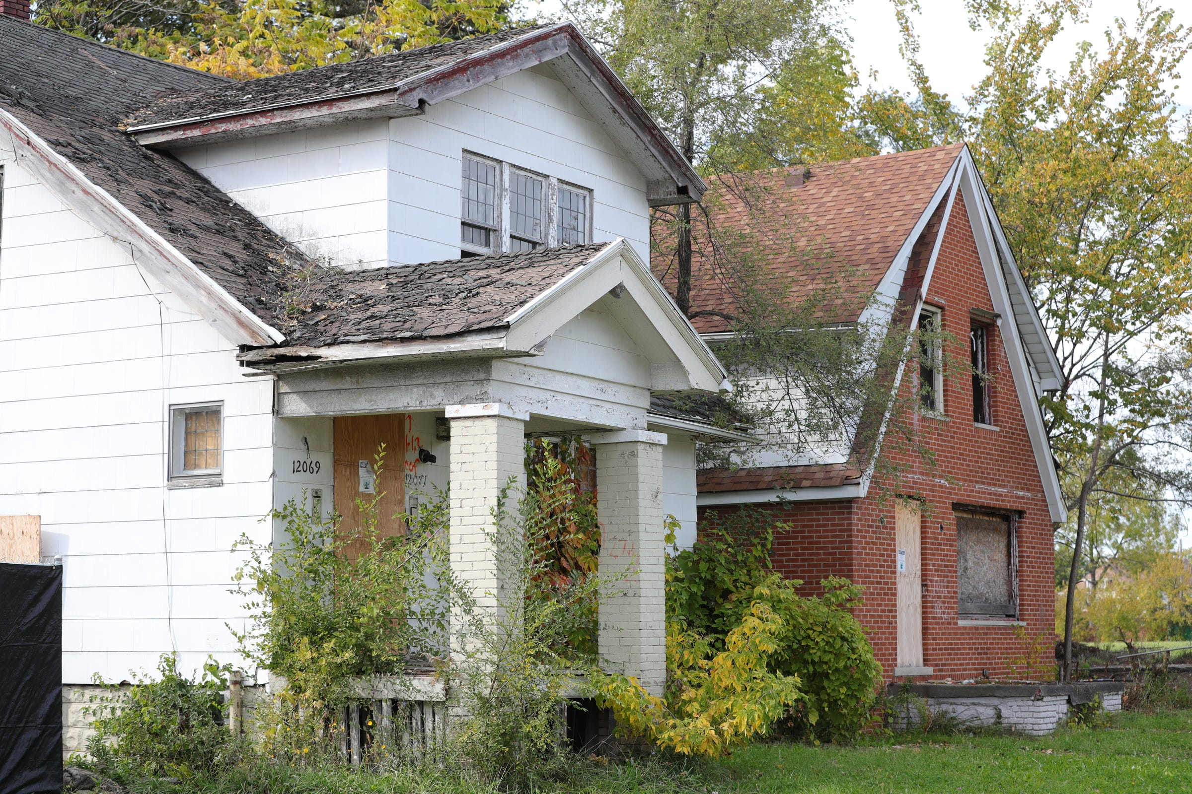 Some of the abandoned homes along Yellowstone Street, near Auntie Na's Village, Saturday, October 19, 2019 in Detroit, Mich.