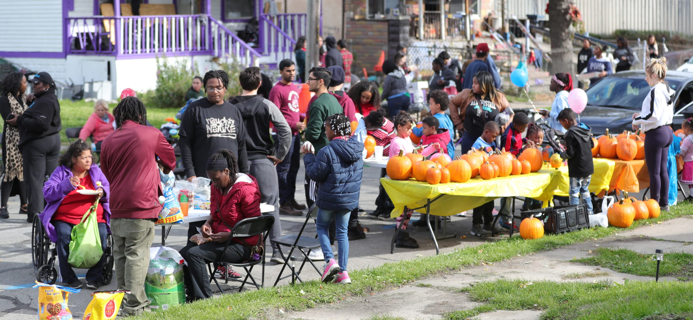 Local residents enjoy activities during the community bazaar put on by Sonia Brown also known as Auntie Na Saturday, October 19, 2019 in Detroit, Mich.