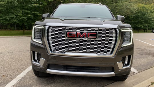 The 2021 GMC Yukon Denali's grille and lights distinguish it from other Yukon models.