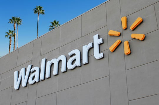 The Walmart logo is seen on the front of a store.  (Dreamstime / TNS)