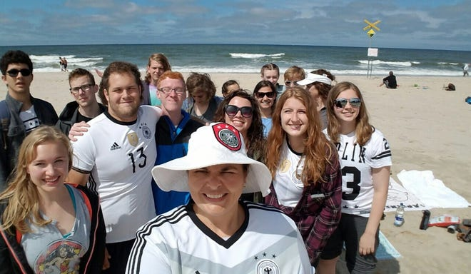 Heidi Hussli and students visit a beach during a class trip to Germany in 2016.