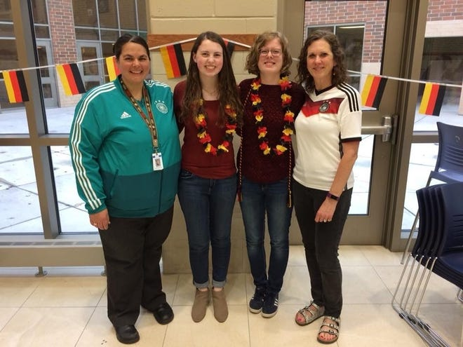 Heidi Hussli (far left) poses for a photo with (from left to right) students Paige Kopke and Lea Kopke, along with fellow teacher Julie Kramer at a German Honors Society induction ceremony in 2018.