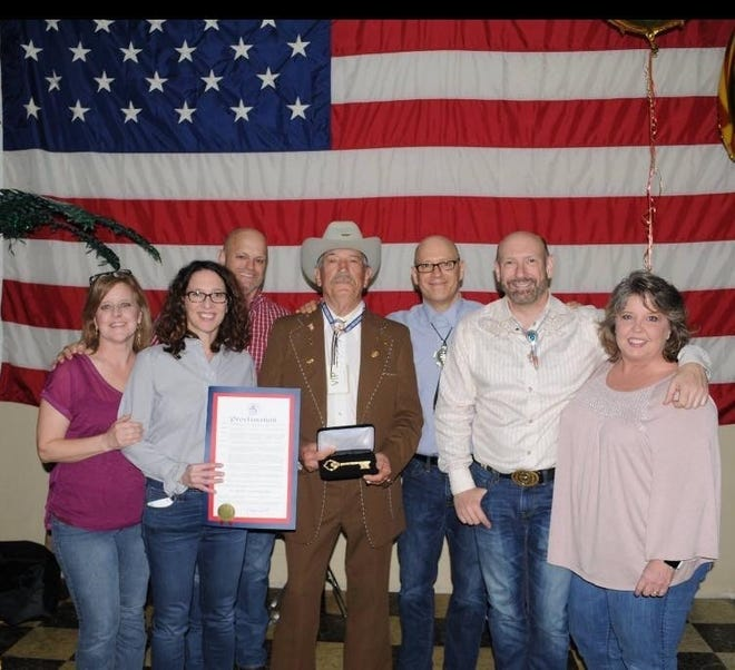 Buddy Glassman, center, received a key to the city and official proclamation from former Jackson Mayor Jerry Gist in March 2018 at his 80th birthday celebration. With him are his children, from left, Terrie Elder, Kim Adkins, Craig Glassman, Glen Glassman, Hal Glassman and Vickie Moore.