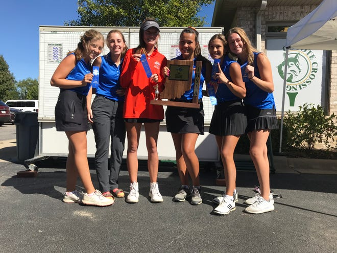 Members of Harrison's girls golf team pose with the sectional championship trophy Friday at Coyote Crossing.