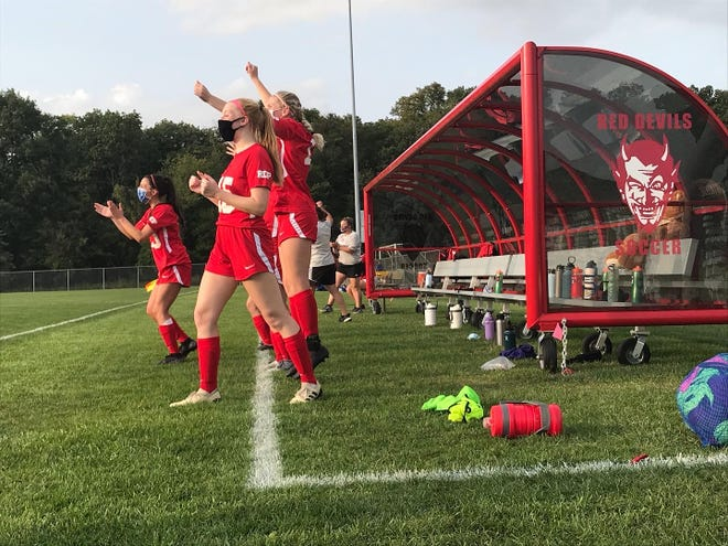 West Lafayette's Cata Posada, Mikayla Bercot and Laney Sturgeon celebrate a goal by Sarah Werth in the final minute of the first half in a 4-2 win over Kokomo.