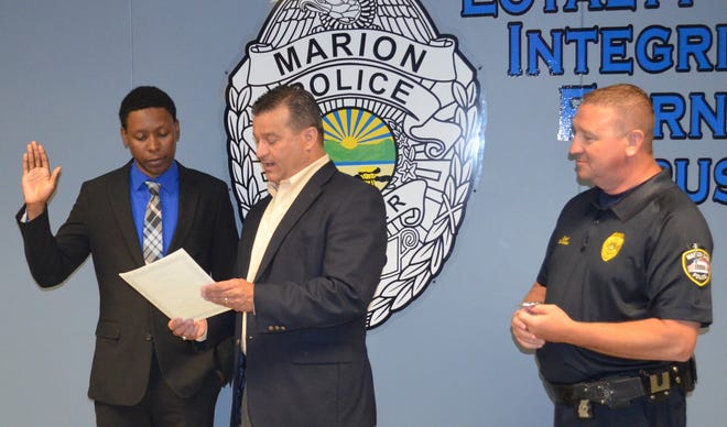 Officer Montel Smith, left, of the Marion Police Department is being sworn in by Marion Mayor Scott Schertzer after Smith joined the police force in 2019. Chief Bill Collins observes the ceremony. Smith is a graduate of the Marion Technical College law and criminal justice program.