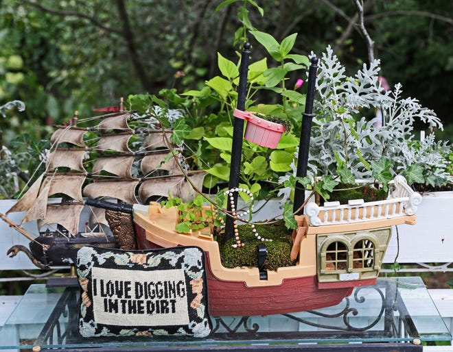 A toy ship is converted into a planter in the Sussex yard of Vanessa (Kiki) and Bob Johanning.