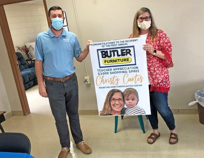 Brad Butler of Butler Furniture presents Mountain Home Kindergarten teacher Christy Curtis with the first Butler Furniture Teacher Appreciation Award, which includes a $3,000 furniture shopping spree.