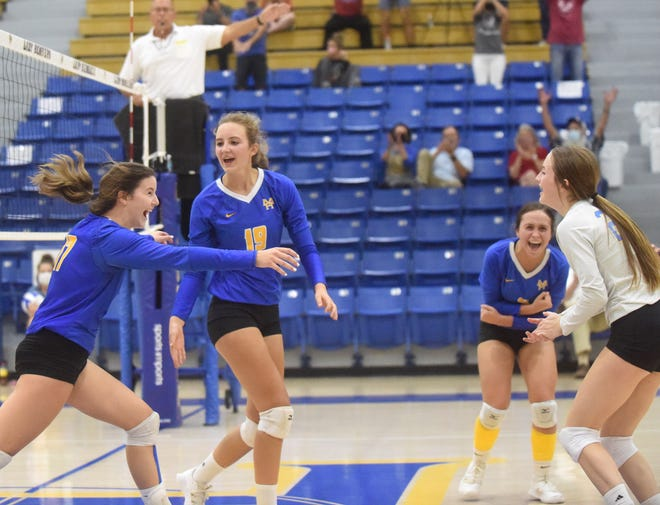 Lady Bombers Kendall Carter, Tatum Smith, Kiah Beard and Riley Schmitz celebrate during their five-set rally over Russellville on Thursday night.
