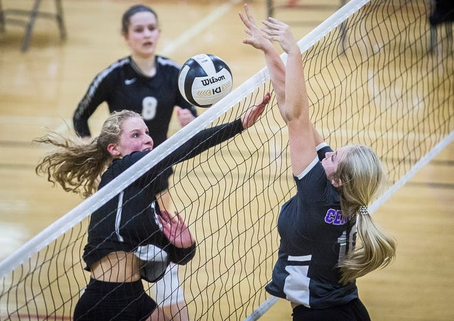 Lexi Franks (right) blocks a ball during Central's 3-0 win over Daleville Thursday, Sept. 17, 2020.