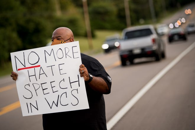 Darius Hollings, of Brentwood, Tennessee, holds a sign during a demonstration before a football game between Ravenwood and Brentwood at Ravenwood High School in Brentwood on Friday, Sept. 18, 2020. The demonstration was in response to a photo circulating on social media that depicts a racial slur about African Americans written on a student's upper body.