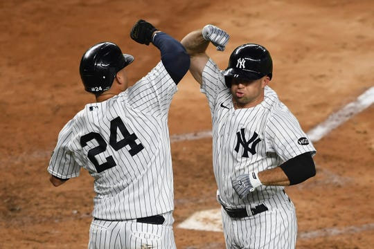 Brett Gardner celebrates with Gary Sanchez (24) after hitting a two-run home run during the fourth inning against the Toronto Blue Jays.
