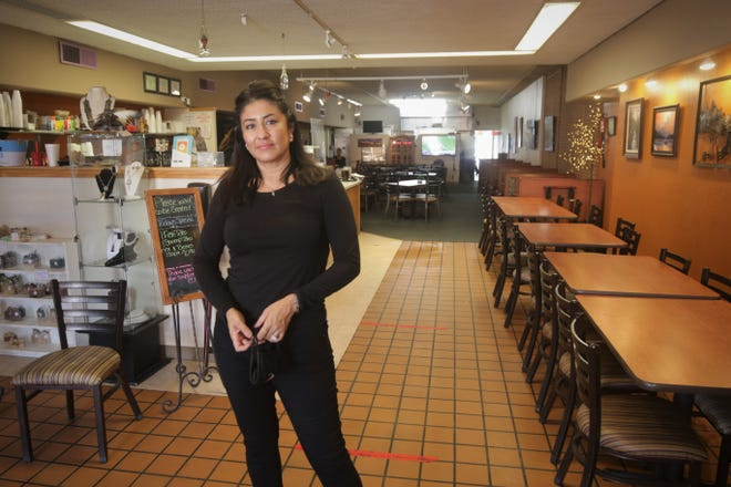 Owner Monica Schultz stands in the entrance of The Chile Pod restaurant in downtown Farmington. Schultz had served as a judge for the Farmington Chamber of Commerce's annual Chile in October event, and her eatery has won several awards in the competition.