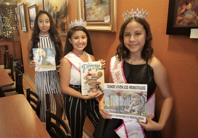 Isabela Esperanza Teresa Gonzalez, left, Gabriela Aranza Teresa Gonzalez and Brianna Marie Pena Begay display some of the stories they'll be reading during the inaugural Hispanic Heritage Virtual Youth Storytelling event next weekend.