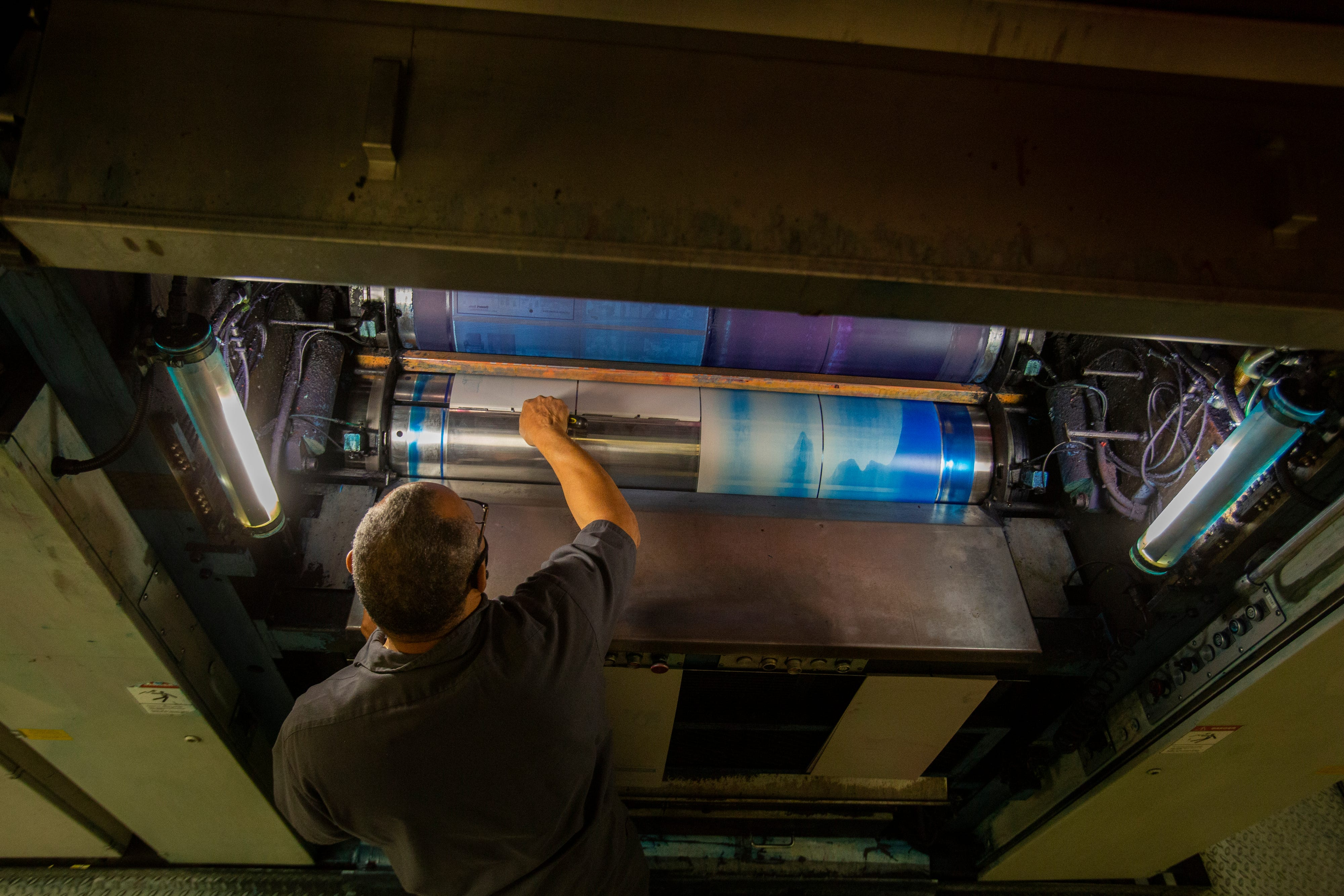 Wendell Saxton, senior press operator, sets plates on the presses. Saxton has been working to put together The Desert Sun newspaper for 35 years.