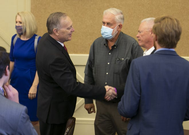 U.S. Rep. Andy Biggs, center left, shakes hands with Jerry Sheridan, center right, Republican candidate for Maricopa County Sheriff, while waiting for Vice President Mike Pence to speak at the Wigwam Resort in Litchfield Park on Sept. 18, 2020.
