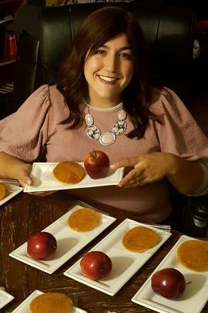 Rachel Levy, a teacher at Shearim Torah High School for Girls, prepares apples and honey cookies for Rosh Hashana.
