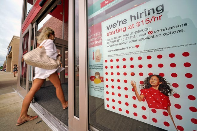 FILE - In this Sept. 2, 2020, file photo, a help wanted sign hangs on the door of a Target store in Uniontown, Pennsylvania. Hundreds of thousands of Americans likely applied for unemployment benefits last week, a high level of job insecurity that reflects economic damage from the coronavirus outbreak. Economists expect that 850,000 people sought jobless aid, down from 884,000 the week before, according to a survey by the data firm FactSet. (AP Photo/Gene J. Puskar, File)