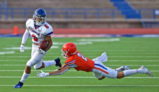 Xavier Monsivais, far left, rushes the ball for Cooper during a scrimmage against Central in San Angelo on Thursday, Sept. 17, 2020.