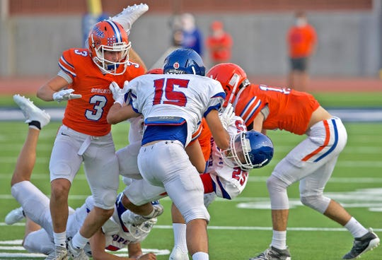 The San Angelo Central defense swarms an Abilene Cooper player during a scrimmage on Thursday, Sept. 17, 2020.