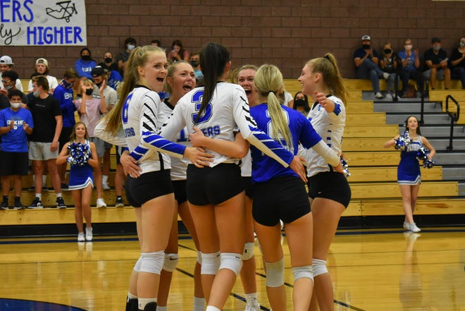 Dixie High volleyball celebrates a point during it's 3-1 win over Desert Hills on Thursday September 17, 2020