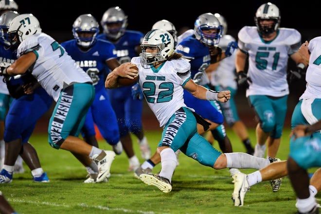 Jensen Beach High School's Andrew Burnette moves the ball through the Sebastian River High School defense on Thursday, Sept. 17, 2020, during a game in Sebastian. Jensen Beach won the game 14-11.