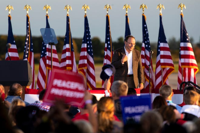 U.S. Rep. Tom Tiffany of Wisconsin speaks at President Donald Trump's Make America Great Again event at Central Wisconsin Aviation on Sept. 17, 2020, in Mosinee.
