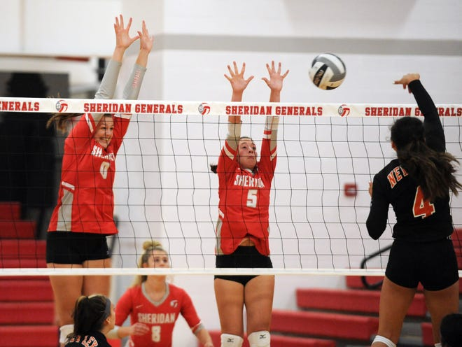 Faith Stinson, left, and Grace Conrad, of Sheridan, go up for a block against New Lexington. Sheridan won the match, 25-13, 25-12, 25-21 to remain unbeaten.