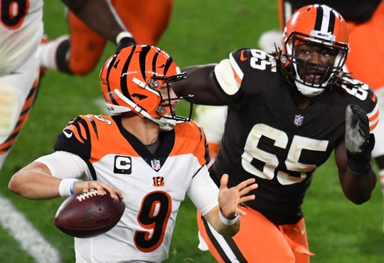 Cleveland Browns defensive tackle Larry Ogunjobi chases Cincinnati Bengals quarterback Joe Burrow.