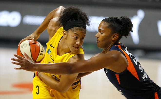 Second round: Los Angeles Sparks forward Candace Parker (3) looks to make a move on Connecticut Sun forward Alyssa Thomas during their single-elimination game on Sept. 17.