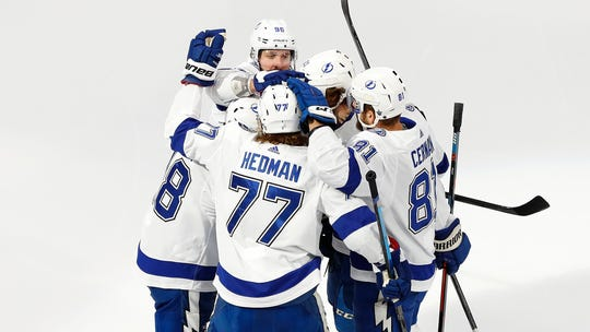 The Tampa Bay Lightning celebrate a first-period goal by defenseman Victor Hedman in Game 6.