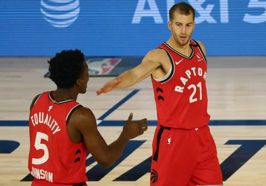 Toronto Raptors guard Matt Thomas (21) celebrates with forward Stanley Johnson (5)  against the Brooklyn Nets during the first round of the 2020 NBA Playoffs.