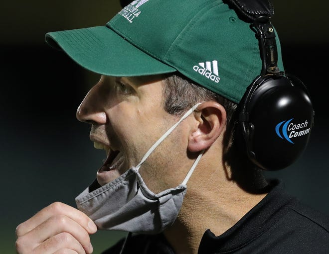 Nordonia football coach Jeff Fox calls plays from the sideline during a game last season. The Knights improved to 2-0 Friday with a 28-27 home win over Berea-Midpark.