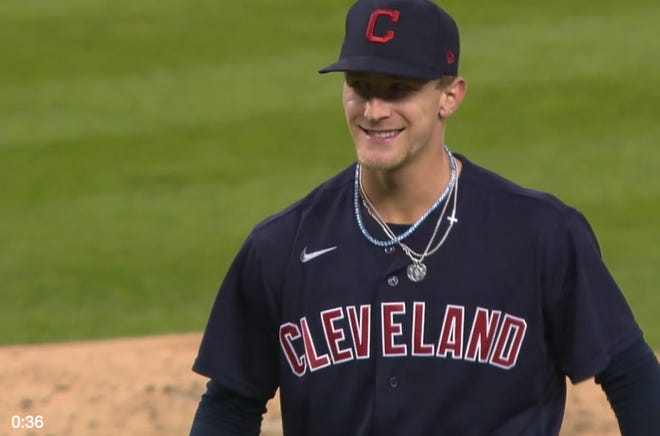 Indians pitcher Zach Plesac comes off the mound smiling after his immaculate inning Friday night.