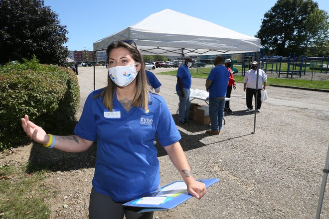 Ashley Rosser, a harm reduction specialist at Thrive Peer Support, talks about the the organization and the need for the community outreach event at House of the Lord on Saturday in Akron. [Mike Cardew/Beacon Journal]