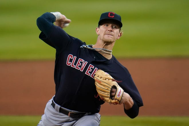 Cleveland Indians pitcher Zach Plesac throws against the Detroit Tigers in the first inning of a baseball game in Detroit, Friday, Sept. 18, 2020. (AP Photo/Paul Sancya)