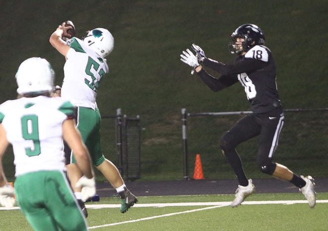 West Branch's Brock Smith (52) intercepts a pass intended for Carrollton's Talen Timberlake (18) during conference action at Carrollton on Friday, September 18, 2020.