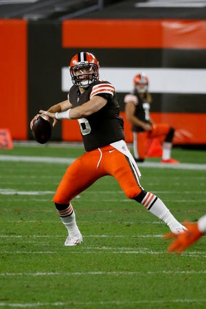 Cleveland Browns quarterback Baker Mayfield (6) drops back to pass during an NFL football game against the Cincinnati Bengals, Thursday, Sept. 17, 2020, in Cleveland. (AP Photo/Kirk Irwin)