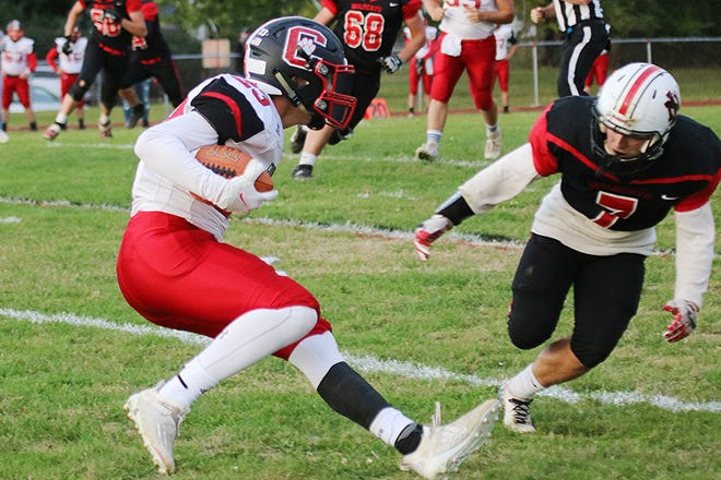 Crestview's Evan Hamilton (23) tries to juke New London's Kenyon Cathey (7) during high school football action Friday at New London Recreation Park. The visiting Cougars won, 62-14.