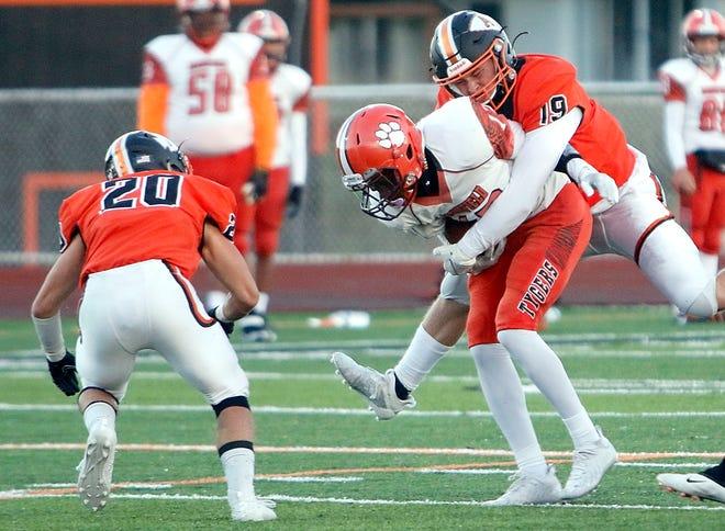 Ashland's Kadin Schmitz (19) tackles Mansfield Senior's Nakari Virden (12) during high school football action Friday at Community Stadium.