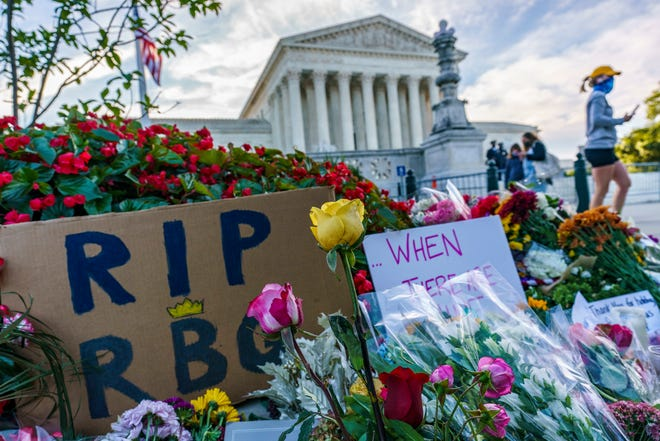 People gather Sept. 19 at the Supreme Court on the morning after the death of Justice Ruth Bader Ginsburg, 87, in Washington.