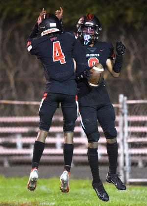 Aliquippa quarterback Vaughn Morris and Antonyo Anderson celebrate after connecting on a touchdown pass during Friday night's game against Ambridge at the Carl Aschman Stadium.