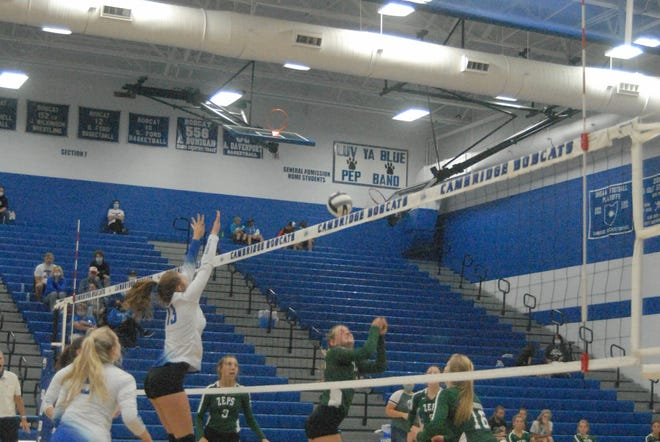 Cambridge's Ryan Dunning (13) goes up for a block against Shenandoah on Saturday in prep volleyball action.