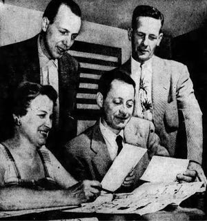 Warren Wefler (seated right) is shown in this 1954 photo from the Akron Beacon Journal. Wefler was part of a committee trying to install a sanitary sewer line near a cottage he owned in the Portage Lakes area.